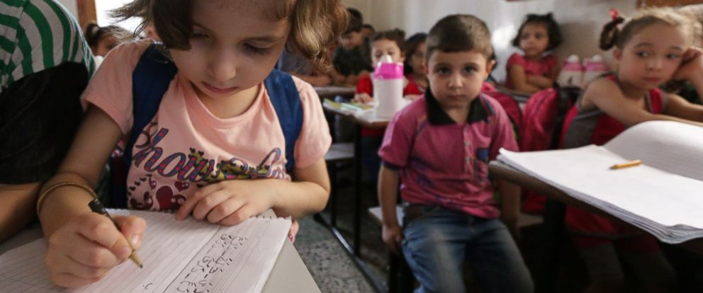 PHOTO: Syrian children attend the first day of school in a rebel-held area of the northern city of Aleppo, on Sept. 6, 2014.