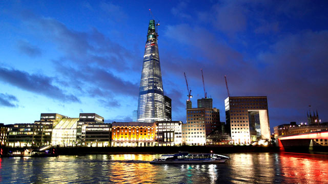 PHOTO: A boat moves along the River Thames against the backdrop of the Shard tower in London, Dec. 13, 2011.