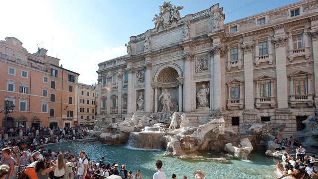PHOTO: Tourists relax at central Rome's Trevi fountain monument on August 12, 2010.