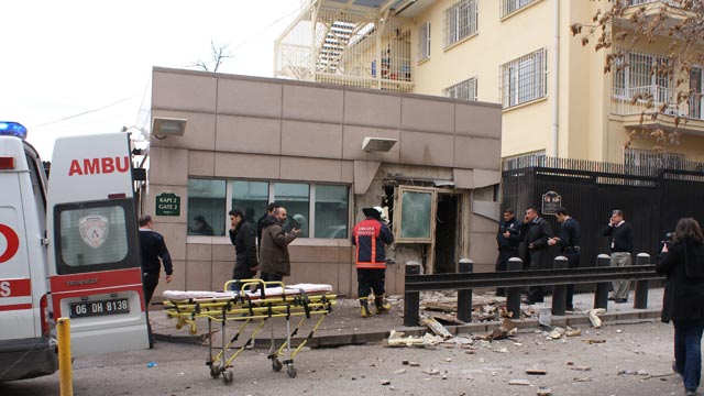 PHOTO: People stand outside the entrance of the US embassy in Ankara, Feb. 1, 2013, after a blast killed two security guards and wounded several other people.