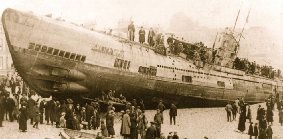 U-boats stranded on the south coast of England after the surrender of Germany in the First World War are surrounded by onlookers on foot and those who have arrived by boat.