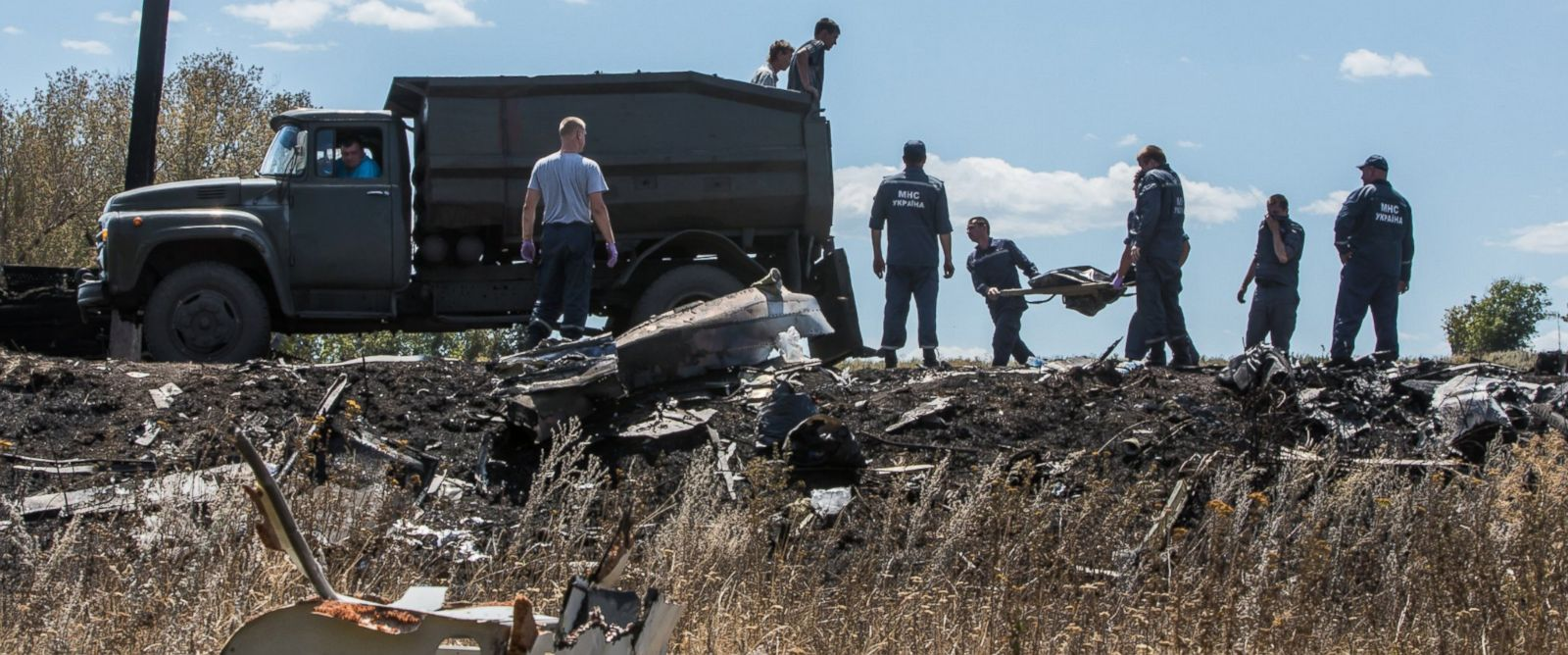 PHOTO: Personnel from the Ukrainian Emergencies Ministry load the bodies of victims of Malaysia Airlines flight MH17 into a truck at the crash site on July 21, 2014 in Grabovo, Ukraine.