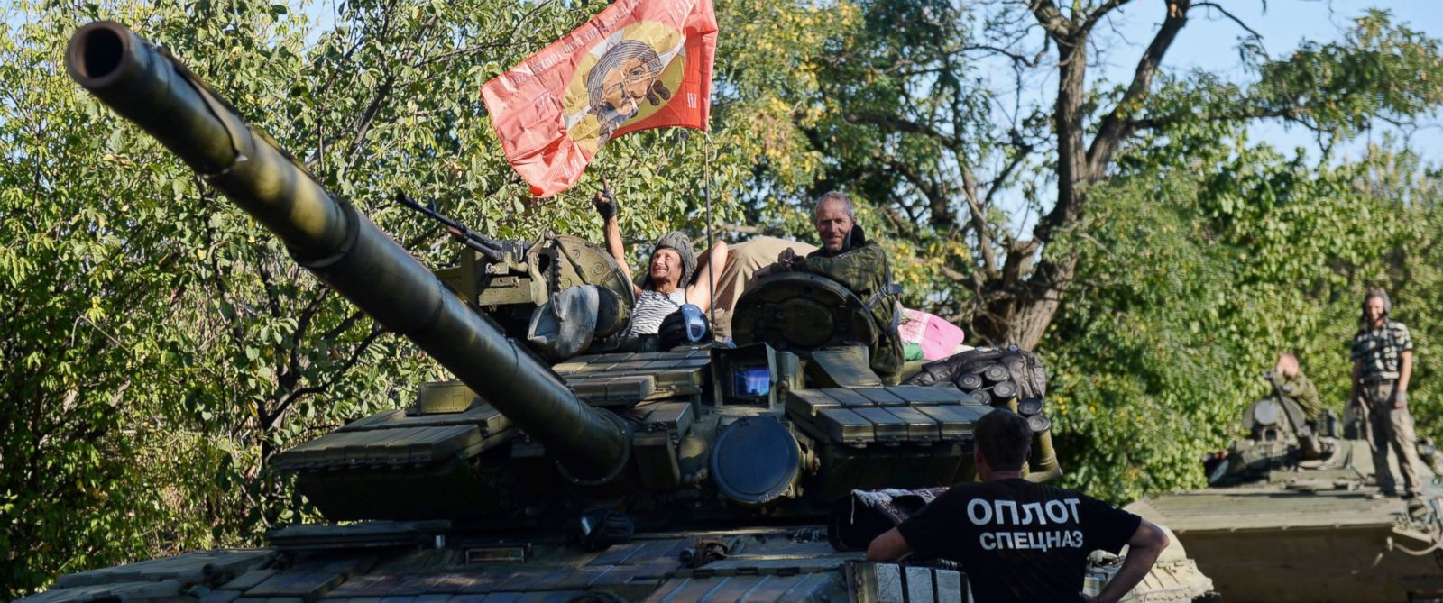 PHOTO: Pro-Russian fighters sit on top of a tank in Starobesheve, Ukraine on Aug. 31, 2014.