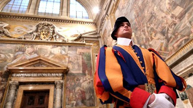 PHOTO: A Swiss guard stands at the Throne's Hall during the courtesy visits to the new appointed cardinals at the Apostolic Palace, Nov. 24, 2012 in Vatican City, Vatican.