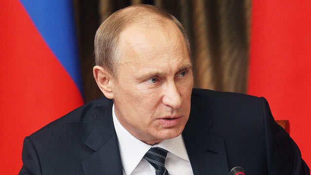 PHOTO: Russian President Vladimir Putin speaks during a meeting with minsters and officials in Elista, April 16, 2013 in the Kalmykia region of Russia.