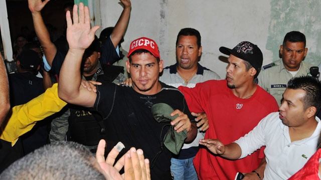 PHOTO: Venezuelan Washington Nationals catcher Wilson Ramos waves as he arrives at his home, after being rescued, Nov. 12, 2011.