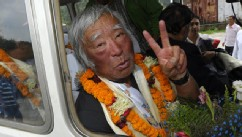 PHOTO: Japanese adventurer Yuichiro Miura gestures upon his arrival at Tribhuvan Airport in Kathmandu on May 26, 2013, after summitting Mount Everest.