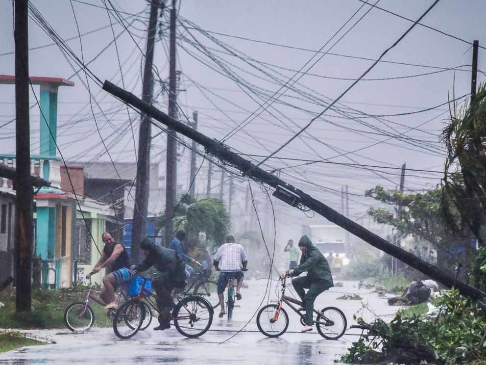 PHOTO: Local residents return home after the passage of Hurricane Irma in Caibarien, Villa Clara province, 330km east of Havana, on September 9, 2017.