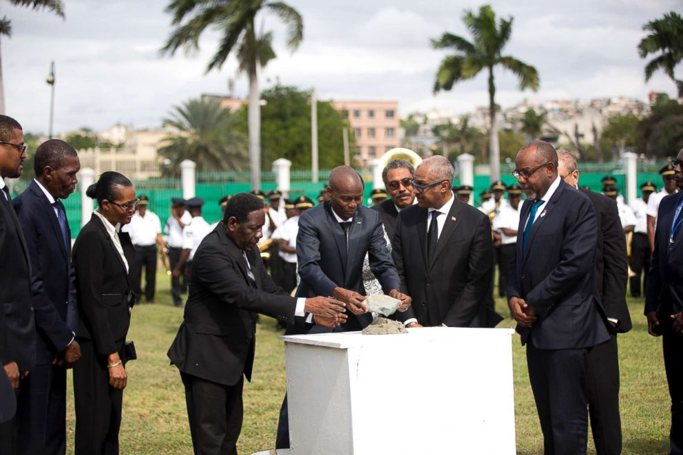 PHOTO: Haitis President Jovenel Moise, center, places the first stone for the construction of a new National Palace on the 8th anniversary of the 2010 earthquake, in Port-au-Prince, Haiti, Jan. 12, 2018.