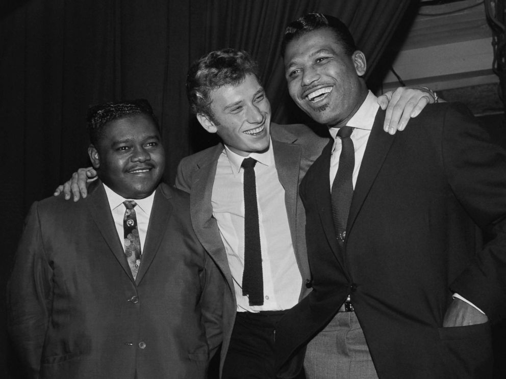 PHOTO: Fats Domino (L) being congratulated by French singer Johnny Hallyday (C) and US boxing champion Ray Sugar Robinson following his performance at the Palais des Sports in Paris, Oct. 20, 1962.