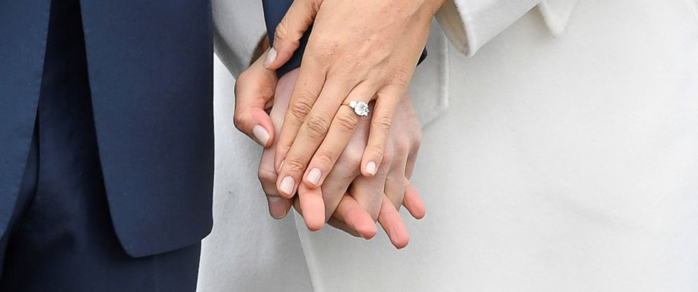 PHOTO: Britains Prince Harry holds hands with Meghan Marklem wearing an engagement ring in the Sunken Garden of Kensington Palace, London, Nov. 27, 2017.