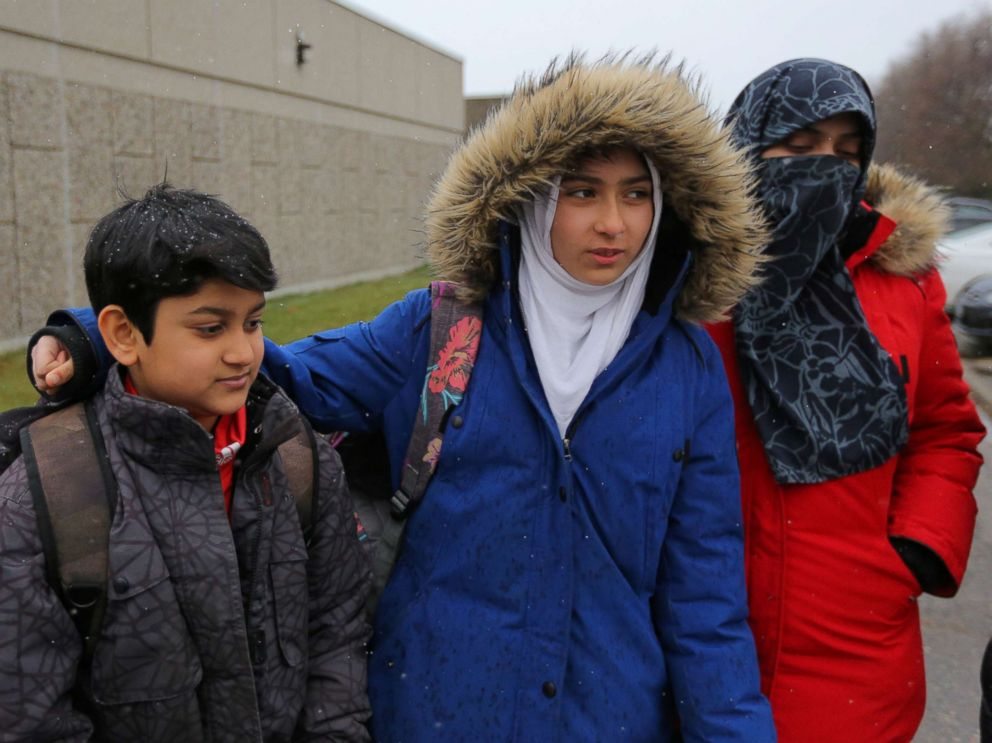 PHOTO: Khawlah Noman,center, with her mother Saima Samad,right, and younger brother after she held a press conference claiming a man cut her hijab with scissors in Toronto, Ontario, Canada, Jan. 12, 2018. The Toronto police are disputing her claim.