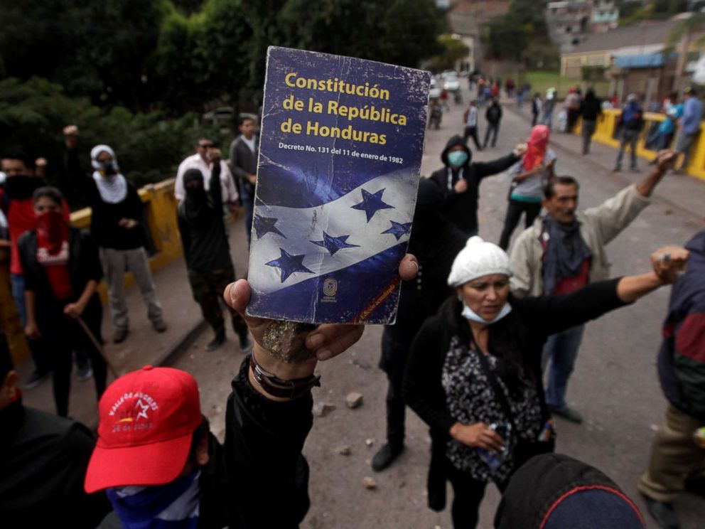 PHOTO: An opposition supporter holds up the Constitution of the Republic of Honduras during a protest over a contested presidential election with allegations of electoral fraud in Tegucigalpa, Honduras, Dec. 22, 2017.