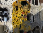 "PHOTO: ""Syrian Museum - Gustav Klimts The Kiss"" is a piece of digital art created by Tammam Azzam, a Syrian artist who uses art to highlight the far-reaching violence and destruction of the ongoing Syrian war."