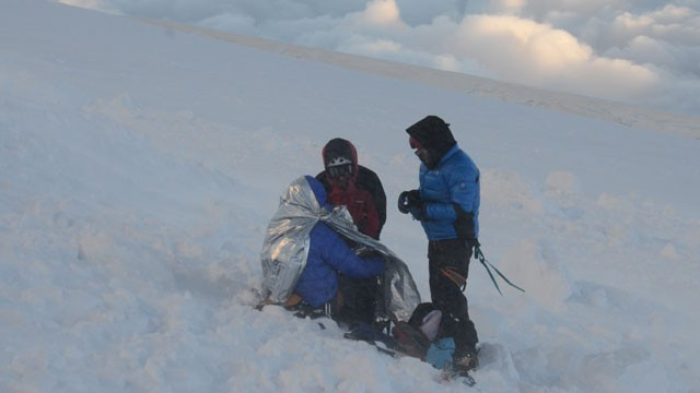 PHOTO:&nbsp;Rescuers put climbers in body heat wraps after at least nine climbers died and nine were injured following an avalanche July 12, 2012 in the French Alps.