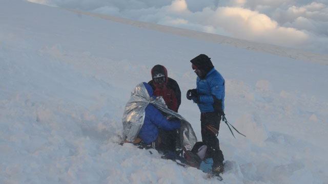 PHOTO: Rescuers put climbers in body heat wraps after at least nine climbers died and nine were injured following an avalanche July 12, 2012 in the French Alps.