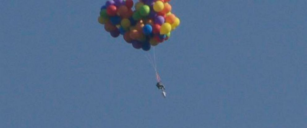 PHOTO: A man attached helium balloons to a lawn chair and soared above Stampede Park in Calgary, Canada on July 5, 2015.