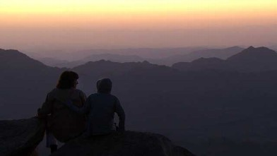 PHOTO: Christiane Amanpour and her son Darius sitting near the top of Mount Sinai just in time to watch the sunrise.