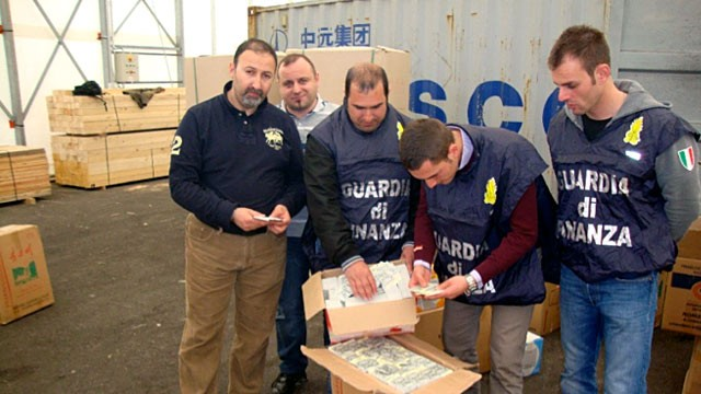 PHOTO: Italian police look at counterfeit train tickets