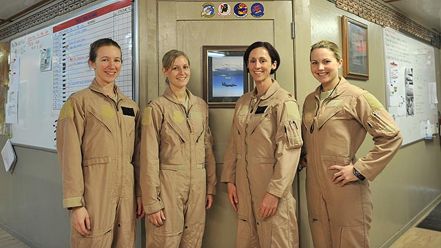 PHOTO: Maj. Tracy Schmidt, Capt. Kimberly Volk, Maj. Christine Mau and Capt. Jennifer Morton pose before their mission March 29, 2011.