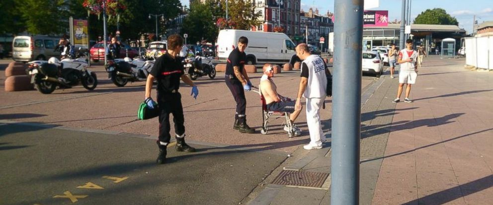 PHOTO: An injured man was taken from Arras station in France after an attack aboard the Paris-bound train.