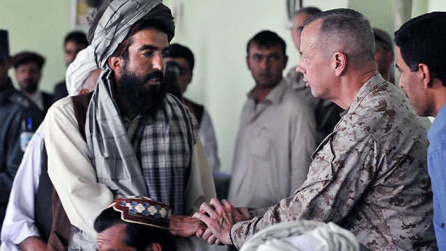 "PHOTO: Gen. John Allen, right, greets villagers from the Baraki Barak district, Afghanistan, who recently lost loved ones due to a ""precision"" strike."