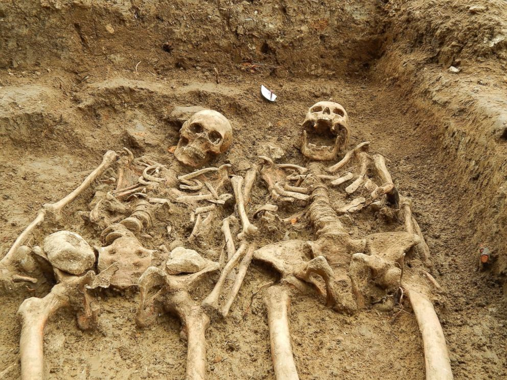 PHOTO: The man and woman were buried together in the same grave with their arms crossed together. Eleven skeletons have been uncovered so far, but the archaeologists believe there may be more.
