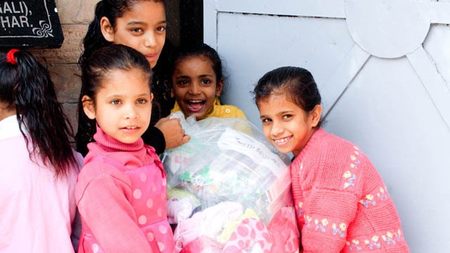 PHOTO: Orphan girls at Unique Home, in Jalandhar, India, receive goods donated thanks to a social-media campaign begun by Deesh Sekhon, of Abbotsford, B.C., in this undated photo.