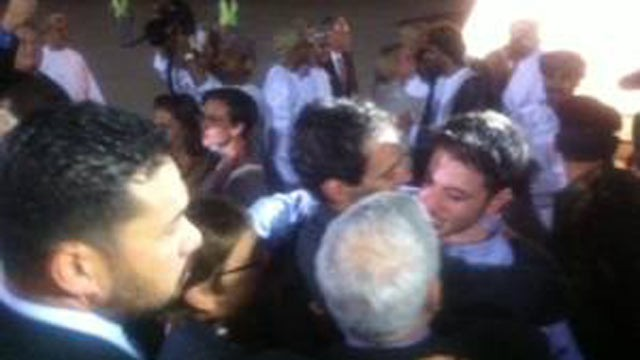 PHOTO: The US hikers freed from jail in Iran land in Oman and are greeted by their families, Sept. 21, 2011.