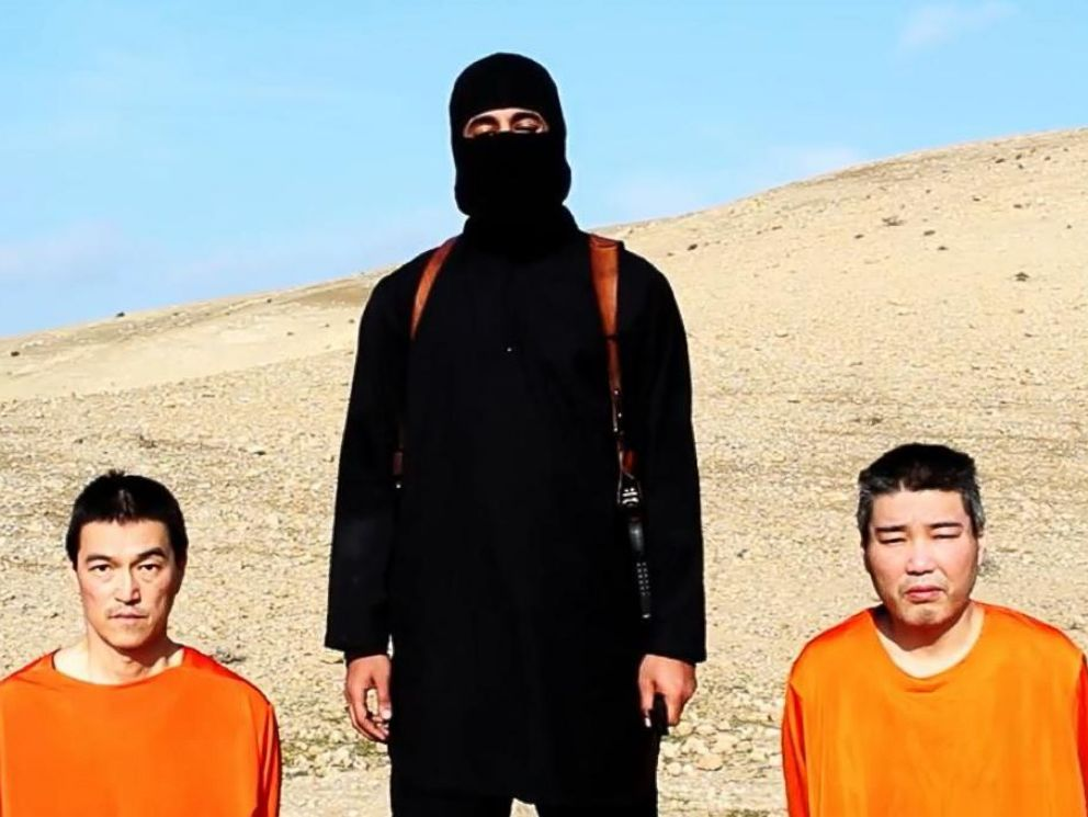 PHOTO: Japanese citizens Kenji Goto Jogo, left, and Haruna Yakawa, right, appear with the man dubbed Jihadi John, center, in a video released by ISIS on Jan. 19, 2015.