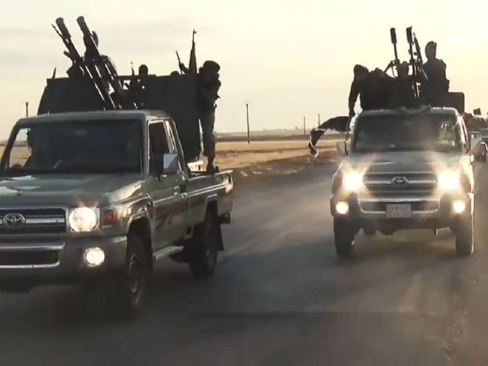 PHOTO: ISIS militants race through Raqqa in a propaganda training film released online in September 2014.