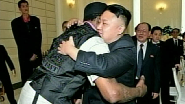 PHOTO: North Korean leader Kim Jong Un hugs former