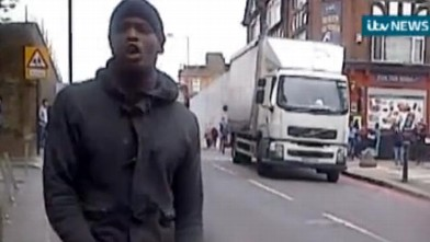 A man that attacked a British soldier in broad daylight reacts to the stabbing in a bystander video obtained by ITV, May 21, 2013.