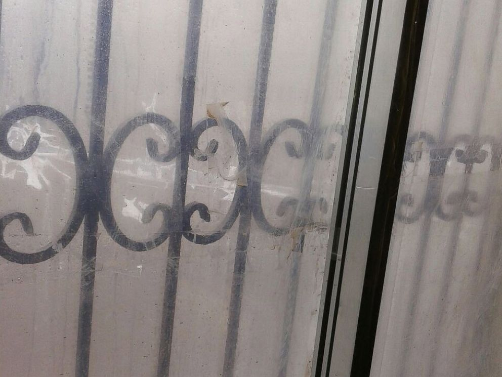 PHOTO: A window in the home occupied by Madaya Mom and her family is covered with plastic after the glass was blown out by shelling.