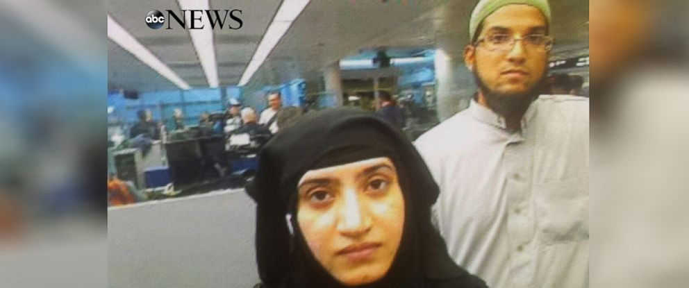 PHOTO: Photo obtained by ABC News shows Tashfeen Malik, center, and Syed Rizwan Farook, right, going through Chicagos OHare International Airport on July 27, 2014.