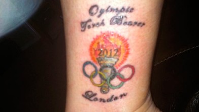 "PHOTO: Jerri Peterson, an Olympic Torchbearer, got a tattoo commemorating the event and the tattoo artist misspelled Olympics as ""Oylimpic"" and tweeted this image on April 13, 2012."