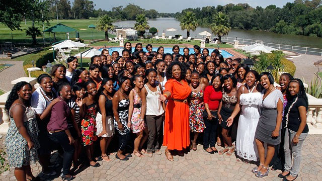 PHOTO: Oprah Winfrey celebrates with the first graduating class of The Oprah Winfrey Leadership Academy for Girls in South Africa.