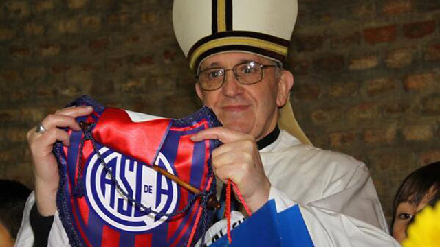 PHOTO: San Lorenzo de Almagro, a club named for a saint, posted on twitter a photo of Pope Francis years ago holding up a club flag, March 13, 2013.