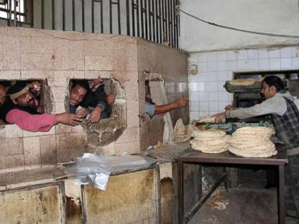 PHOTO: Mayhem as customers attempt to buy bread at a Syrian bakery.