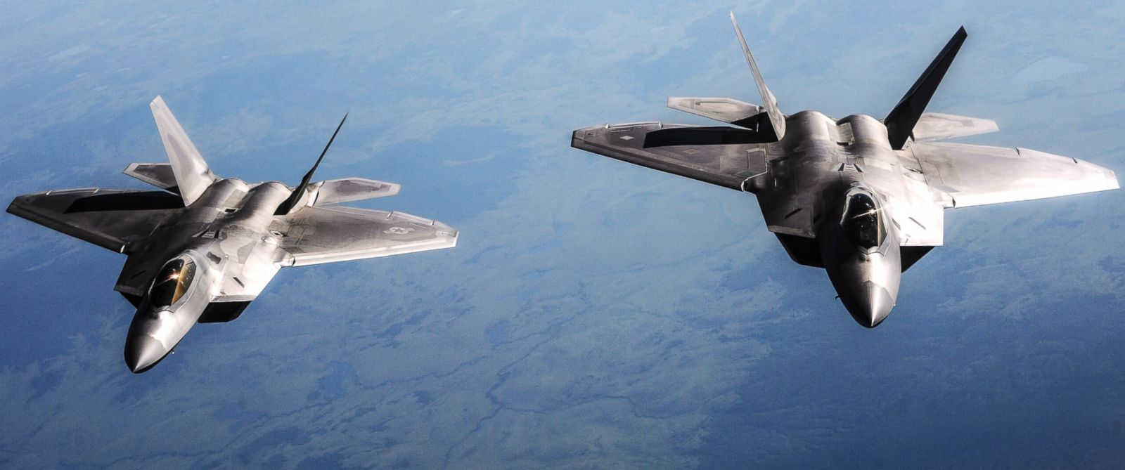 PHOTO: Two U.S. Air Force F-22 Raptor aircraft fly behind a KC-135 Stratotanker aircraft, not shown, during Red Flag-Alaska 13-3 over the Joint Pacific Alaska Range Complex Aug. 14, 2013.