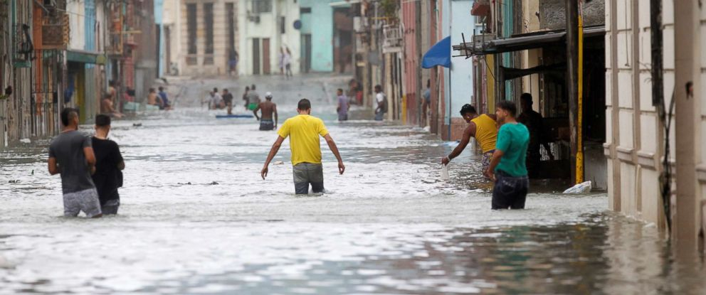 PHOTO: People wade through a flooded street after the passing of Hurricane Irma, in Havana, Cuba, Sept. 10, 2017.