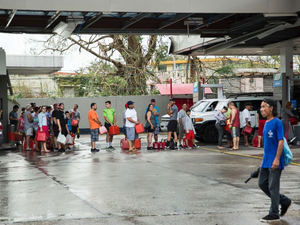 PHOTO: People line up to fill gas cans after Hurricane Maria in San Juan, Puerto Rico, Sept. 21, 2017.