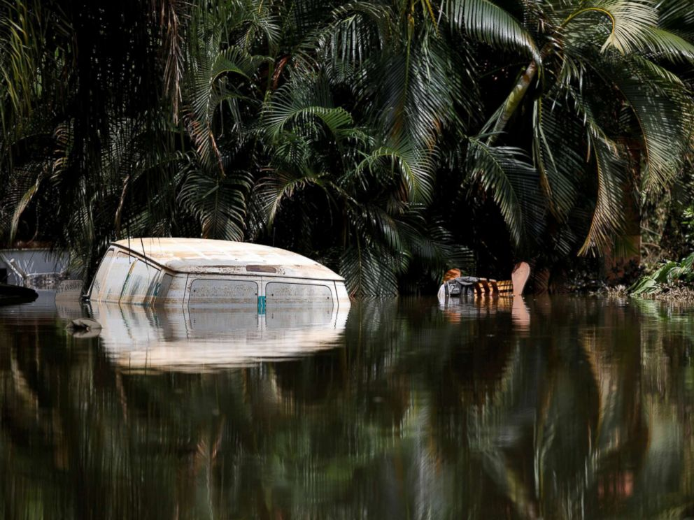 PHOTO: A car submerged in flood waters is seen close to the dam of the Guajataca lake after the area was hit by Hurricane Maria in Guajataca, Puerto Rico, Sept. 23, 2017.