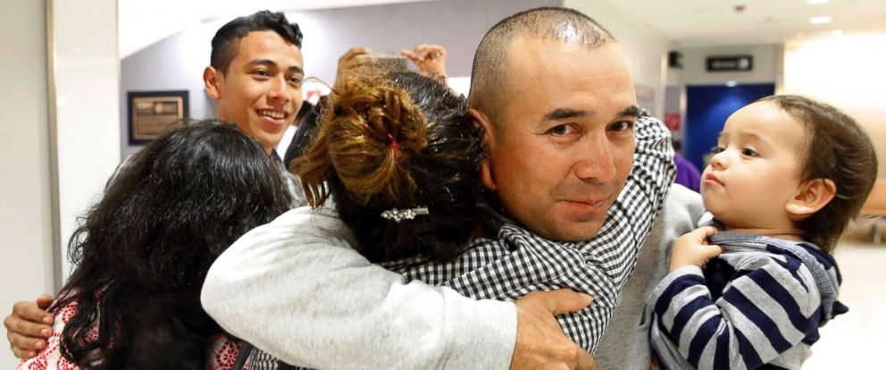 PHOTO: Gabriel Mejia hugs his daughter Wendy, 16, as he holds his son Elias, 1, after her arrival from El Salvador at Baltimore-Washington International Airport on Nov. 12, 2015 in Linthicum, Md.