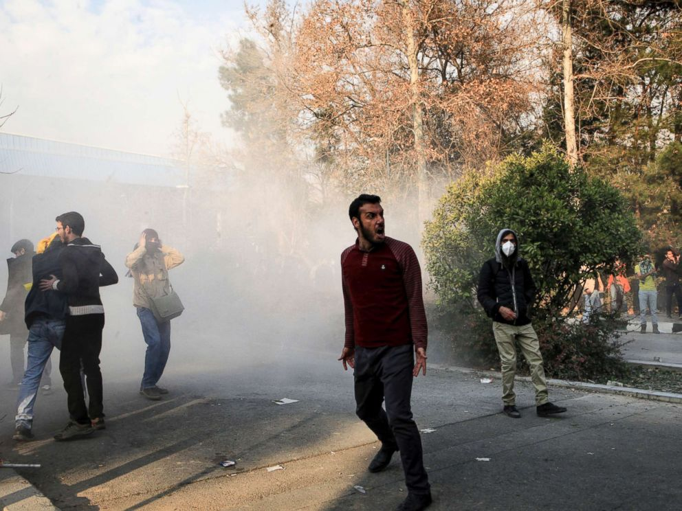PHOTO: University students attend a protest inside Tehran University while a smoke grenade is thrown by anti-riot Iranian police, in Tehran, Iran, Dec. 30, 2017, in a photo obtained by AP.