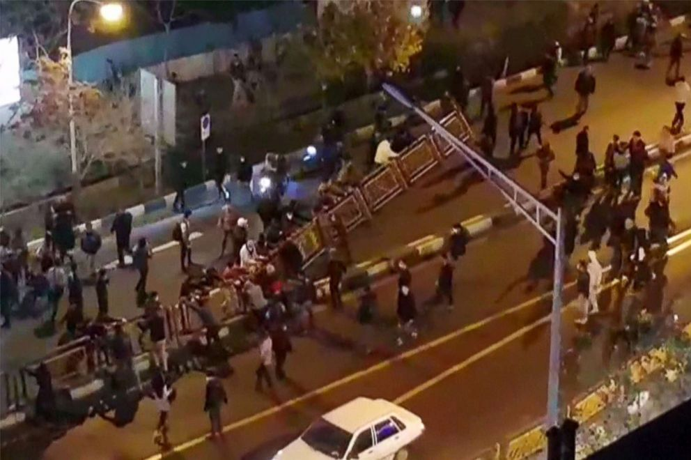 PHOTO: A group of people pull down at a fence in a street during protests in Tehran, Iran, Dec. 30, 2017, in an image taken from video released by Irans Mehr News agency.