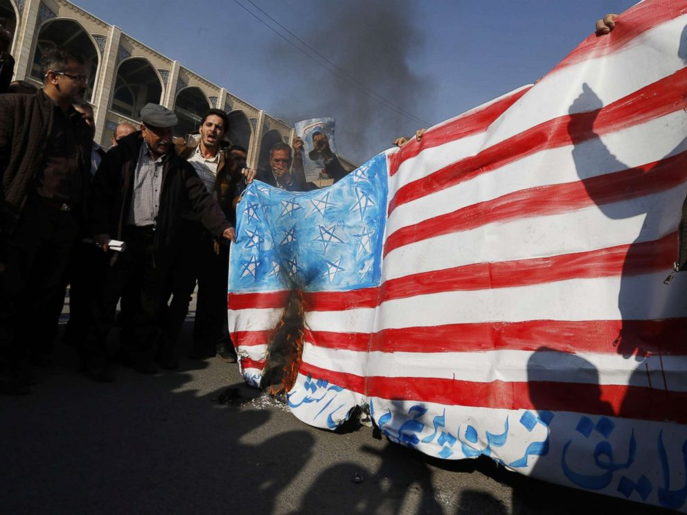 PHOTO: Iranian pro-government demonstrators set a makeshift US flag on fire during a march after the weekly Muslim Friday prayers in Tehran, Jan. 5, 2018.