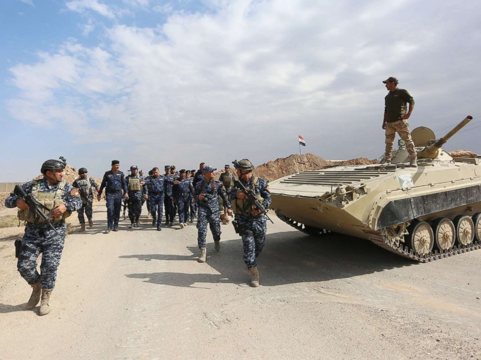 PHOTO: Iraqi federal police forces take up position in Rashad town, southern Kirkuk, north of Iraq, Oct. 13, 2017.