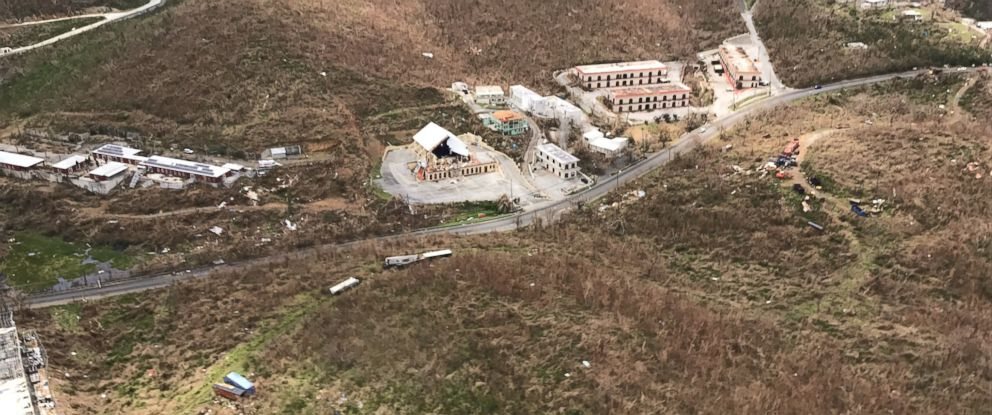 PHOTO: Damage to buildings including a church with a toppled steeple is seen from air over St. Thomas in the U.S. Virgin Islands after Hurricane Irma struck.
