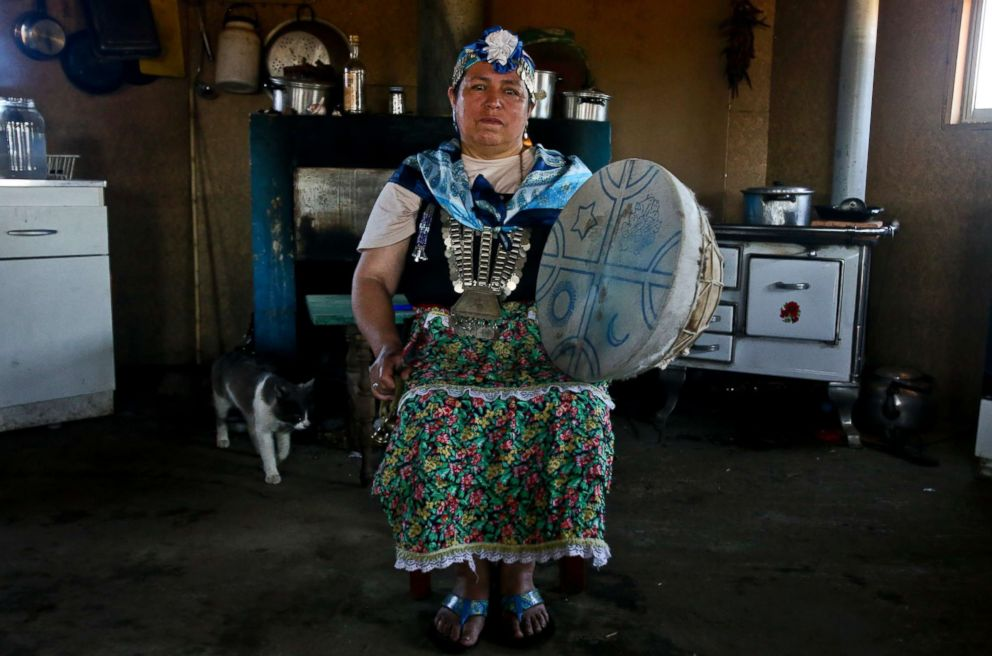 PHOTO: Kallfurayen Llanquileo, a Mapuche healer and religious leader known as a Machi, poses for a photo with her shaman drum at her home in the Mapuche community Enoco in Temuco, Chile, Jan. 8, 2018.